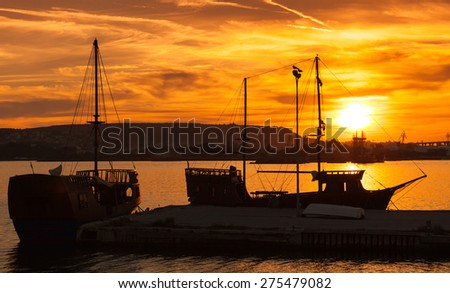 Recreation sailing ships stand moored in Varna port at the sunset. Black Sea coast, Bulgaria - stock photo