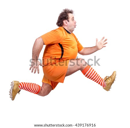 Recreational footballer running isolated on a white background. Fat soccer player runs on white background. Obese man trained in clothes football player. - stock photo