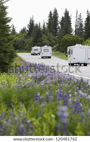 Recreational vehicles on a rural road - stock photo