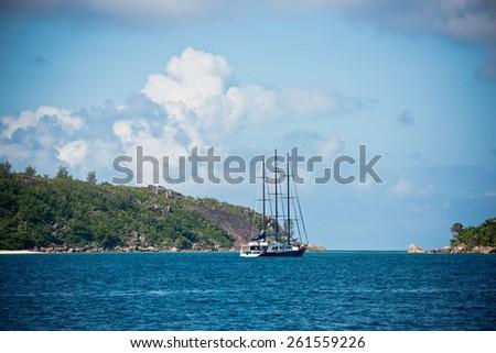 Recreational Yacht at the coast of Seychelles. Horizontal shot - stock photo