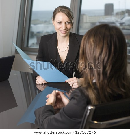 Recruiter checking the candidate during job interview - stock photo
