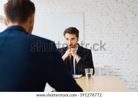 Recruiter listen to candidate during job interview - stock photo