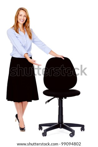 recruitment concept business woman standing with empty office chair isolated on white - stock photo