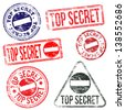 Rectangular and round top secret rubber stamps  - stock photo