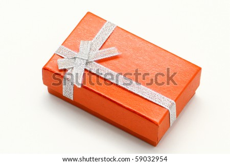 Rectangular orange gift box isolated on white - stock photo