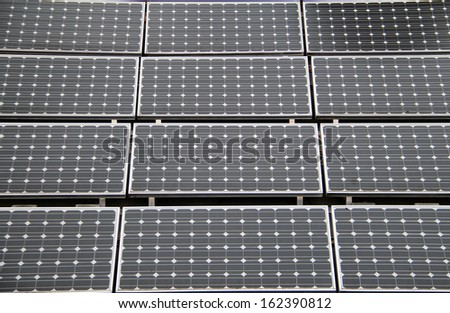Rectangular solar panels on a roof top. - stock photo