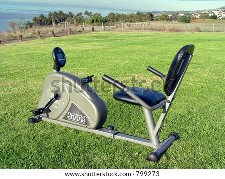 Recumbent Spinning Bike On Sea Cliff! - stock photo