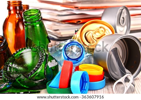 Recyclable garbage consisting of glass, plastic, metal and paper. - stock photo
