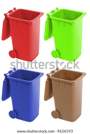 recycle bin in green, yellow, red and blue - stock photo