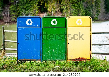 Recycle bins for collection of recycled materials. Colored trash cans. - stock photo