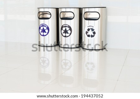 Recycle bins with text in Spanish - stock photo