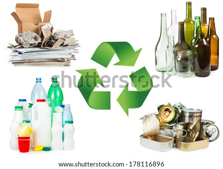 Recycle concept. A selection of garbage for recycling. Segregated metal, plastic, paper and glass on white background