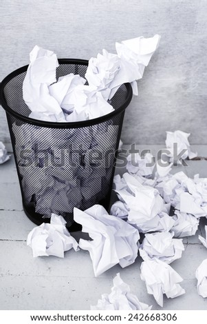 Recycle. Crumpled paper in the trash can - stock photo