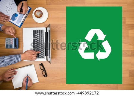 Recycle Green bio eco forest saving environment harmony ecosystem conservation csr esg campaign Business team hands at work with financial reports and a laptop - stock photo