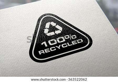 Recycle logo hot stamped on recycled paper background. - stock photo