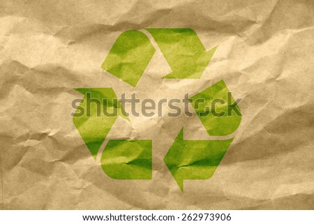 recycle logo on recycled paper - stock photo