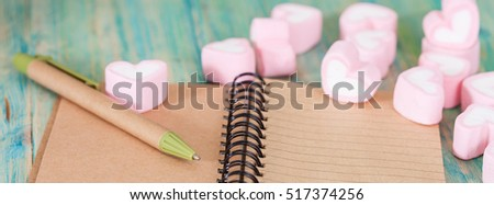 recycle note book and pen with sweet heart shape on 