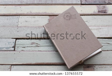 Recycle notebook on grunge background - stock photo