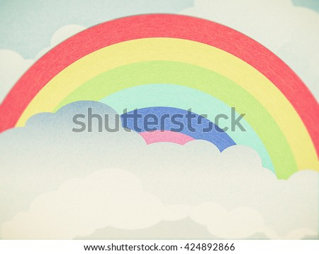 recycle paper cloud and rainbow background - stock photo
