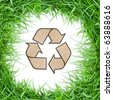 Recycle sign and cycle grass - stock photo