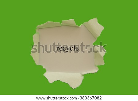 Recycle word written under torn paper. - stock photo
