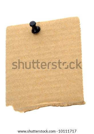 Recycled cardboard note paper with black pushpin in white background - stock photo