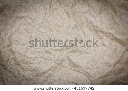 Recycled crumpled brown paper texture or paper background with copy space for text or image. Dark edged. - stock photo