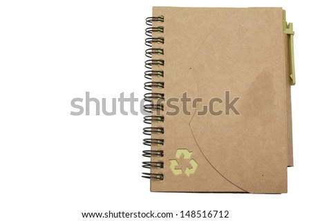 recycled paper notebook with Recycle logo and pen - stock photo
