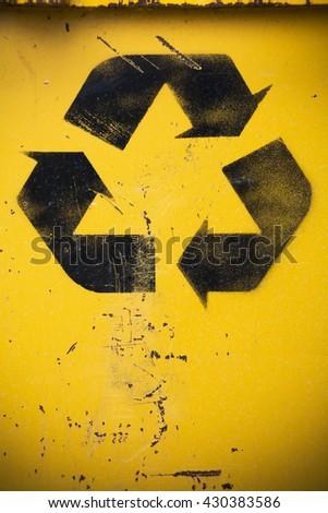 Recycled sign on weathered background - stock photo