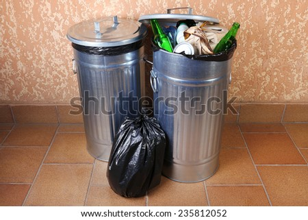 Recycling bins on wall background - stock photo