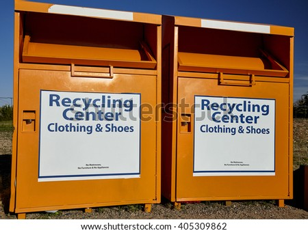 Recycling center collection bins for clothing disposal industry and waste management - stock photo