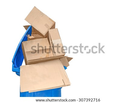 Recycling empty boxes. Open blue plastic recycle bin filled with empty brown cardboard shipping boxes piled high. Isolated on a white background. Copyspace.  - stock photo
