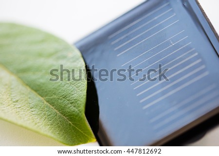 recycling, energy, power, environment and ecology concept - close up of solar battery or cell - stock photo