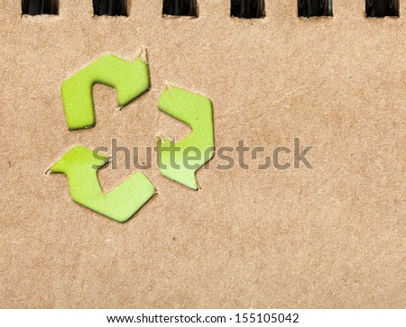 recycling icon on the brown paper