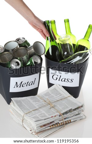 Recycling: metal, glass and paper. isolated background - stock photo