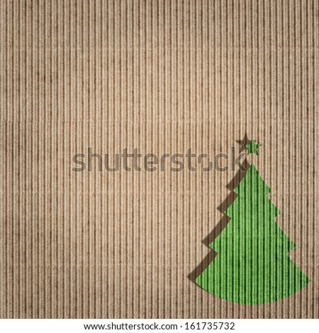 recycling paper with green christmas tree. environment friendly card concept. paper texture.  - stock photo