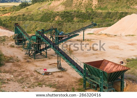 Recycling plant material gravel pit with ribbons distribution and gravel piles of gravel or sand for the construction industry - stock photo