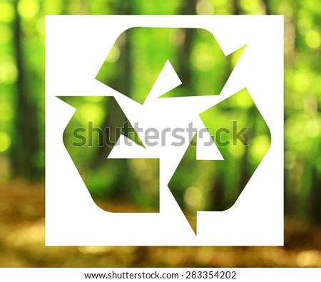 Recycling sign forest in background - stock photo