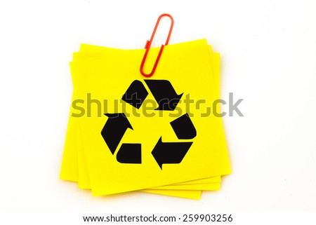 Recycling symbol against sticky note with red paperclip - stock photo