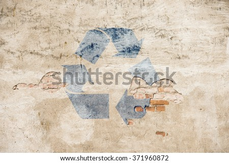 Recycling symbol on stone wall. Concept of environment, reuse and green lifestyle. - stock photo