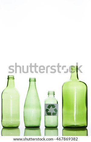 Recycling symbol with bottles