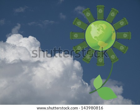Recycling wheelie bin flower with green earth against a cloudy blue sky