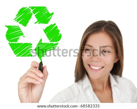 Recycling. Woman drawing recycle sign on copy space. Smiling young business woman smiling on white background. Asian / Caucasian female model. - stock photo