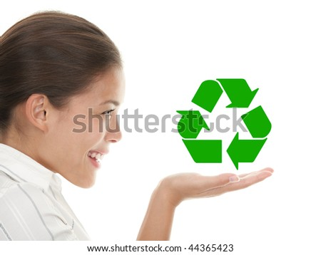 Recycling woman holding the international icon / symbol for recycling.  Beautiful young mixed race chinese / caucasian woman in profile. Isolated on white background - stock photo