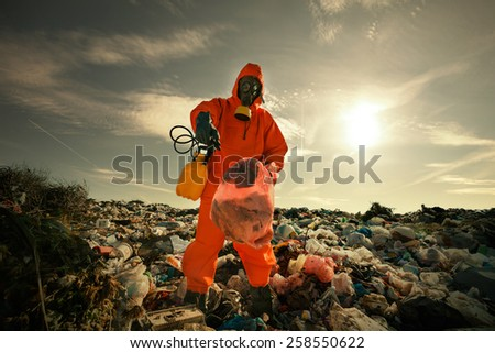 Recycling worker inspecting wastes according to landfill waste acceptance criteria. - stock photo