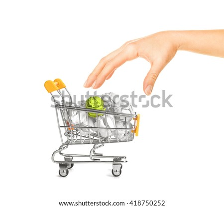 Recylcing concept with crumpled paper and shopping cart - stock photo