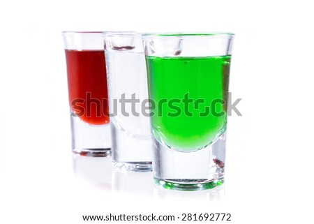 red absinthe, vodka and green absinthe - stock photo