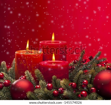 Red advent flower arrangement with burning candles - stock photo