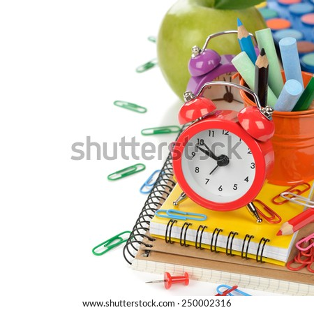 Red alarm clock and office supplies on a white background - stock photo
