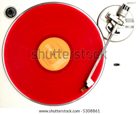 red album on turntable - stock photo